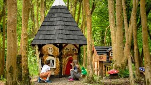Children playing a fairy house in the woods