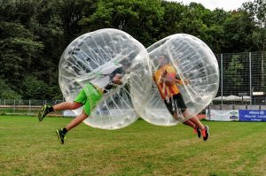 Two men playing Bubble Football