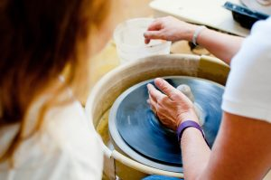 Woman making a piece of pottery