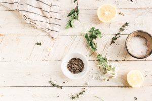 Flat lay of herbs, salt and lemon